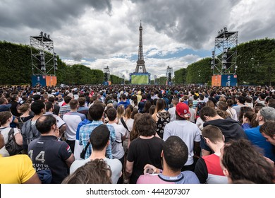 Paris, FRANCE - June 28, 2016 : Crowd of supporters inside the fan zone of the Eiffel Tower during the match between France and Ireland for the Euro 2016.