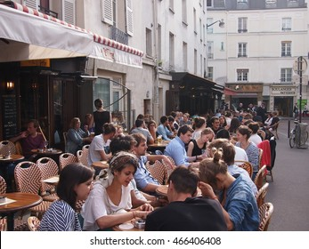 Paris, France - June 28, 2016: Students drinking in the sunshine in the Latin quarter of Paris