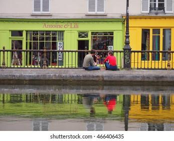 Paris, France - June 28, 2016: Colourful cafes on Canal St. Martin in Paris