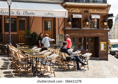 Paris, France - June 28, 2016: A traditional restaurant in Paris, in the Butte Montmartre. Montmartre area is most popular destinations in Paris.