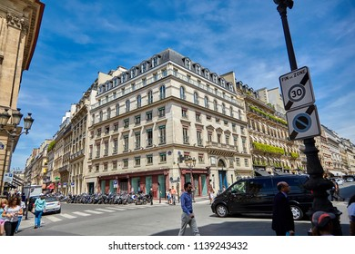 Paris, France - June 29, 2015: The streets of Rue de la Paix and Rue des Capucines. Beautiful facades of old buildings, people crossing the road