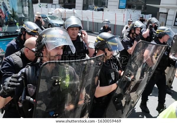 PARIS, FRANCE - JUNE 29, 2019: CRS police blockade in Paris as part of the 33rd Gilets Juanes (yellow vest) riot.