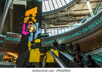 "PARIS, FRANCE - JUNE 3, 2015: Interior of shopping mall ""Four Seasons"" near Arche de la Defense, Paris. It has many retail shops as well as cafes and restaurants."
