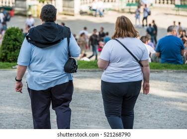 Paris, France- June 30, 2013: fat couple lovers walking in a park near the butte montmartre