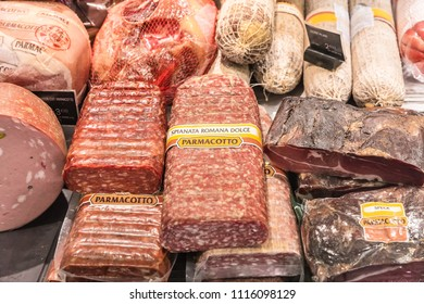 Paris, France - June 30, 2017: Assorted different kinds of meat: salami, sausages, ham, smoked meat and delicatessen products on display in a French supermarket.