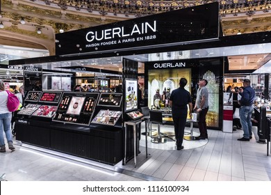 Paris, France - June 30, 2017: People shop in the Guerlain section in the Galeries Lafayette, most famous upmarket French department store since 1912.