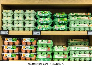 Paris, France - June 30, 2017: Assorted different kinds of fresh organic (bio) eggs in cartons on display in a French supermarket.