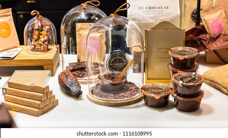 Paris, France - June 30, 2017: Alain Ducasse Chocolate Bar. Assorted different kinds of premium chocolate products on display in a French supermarket.