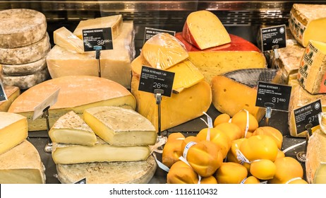 Paris, France - June 30, 2017:  A large selection of different french and italian cheeses on  display in a French supermarket.