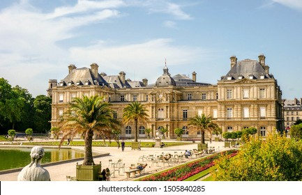 Paris, France - June 30, 2019 - Luxembourg Palace in Luxembourg Garden, seat of the French Senate (upper chamber of the French Parliament), with people chilling on chairs and benches during heat wave