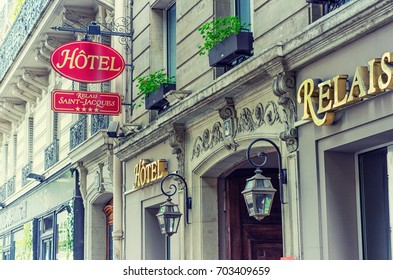 Paris, France - June 4, 2017: Side view of upper part of four stars hotel Relais Saint Jacques entrance is located at 3 Rue de l'Abbe de l'Epee. Its name made with golden letters is placed on facade