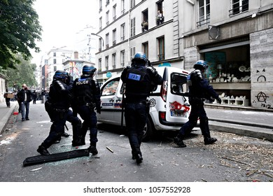 Paris, France June 4,2016. Riot police officers turn a smashed car during march in the 3rd anniversary of the death of young far-left activist Clement Meric who died in a fight with skinheads in Paris