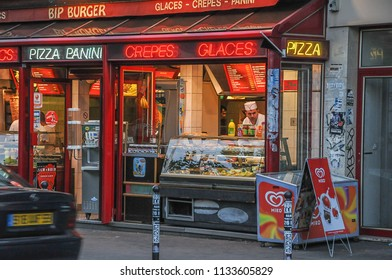 Paris, France - june 6, 2008: Fast food place, in the streets of Montmartre district with night lighting