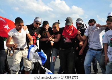 Paris, France - June 6, 2010: Pro-Palestinian demonstration  to protest  Israel's deadly attack on a flotilla heading to Gaza.