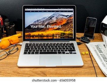 PARIS, FRANCE - JUNE 6, 2017: Apple Computers website on MacBook Retina in creative environment showcasing latest macOS High Sierra from Apple at WWDC 2017 - presentation of the new operating system