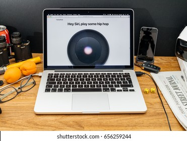 PARIS, FRANCE - JUNE 6, 2017: Apple Computers website on MacBook Retina in creative environment showcasing latest news from Apple at WWDC 2017 - Hey Siri play some Hip Hop on Home Pod