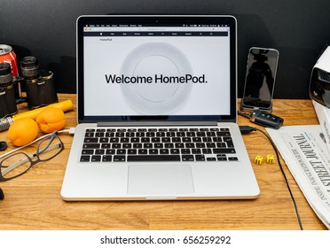 PARIS, FRANCE - JUNE 6, 2017: Apple Computers website on MacBook Retina in creative environment showcasing latest news from Apple at WWDC 2017 - Welcom HomePod with Siri