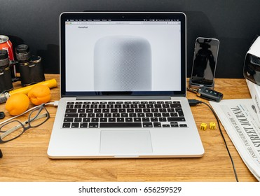 PARIS, FRANCE - JUNE 6, 2017: Apple Computers website on MacBook Retina in creative environment showcasing latest news from Apple at WWDC 2017 - introducing the HomePod a high-fidelity sound speaker