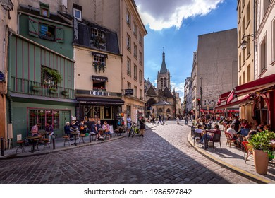 Paris, France - June 6, 2021: Days after lockdown due to covid-19 in a famous Parisian pastry shop in Notre-Dame district in Paris