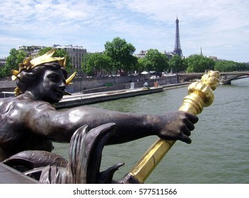 PARIS, FRANCE - JUNE 8, 2013: Back view of one Nymph of the Seine on the Pont (Bridge) Alexandre III  vandalized by lovers.
