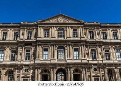 PARIS, FRANCE - JUNE 8, 2015: View of Louvre building at courtyard of Louvre Museum. Louvre Museum is one of the largest and most visited museums worldwide.