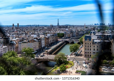 Paris France. - June 8, 2017: Panoramic view of Paris that tourists had when visiting the Cathedral of Notre Dame, we can see the protective mesh in the foreground