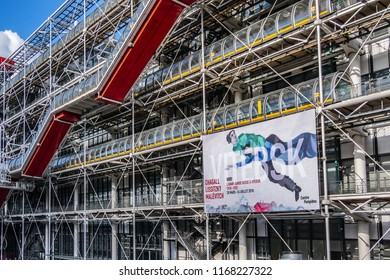 PARIS, FRANCE - JUNE 8, 2018: Fragments of Centre Georges Pompidou (1977) building in Paris with a billboard of the exhibition of paintings by avant-garde artists Chagall, Lisitsky and Malevich.