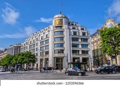 PARIS, FRANCE - JUNE 8, 2018: Superb Art Deco building of Louis Vuitton Store on Champs-Elysees. Louis Vuitton store Champs-Elysees (company flagship store) is largest Vuitton store in the world.