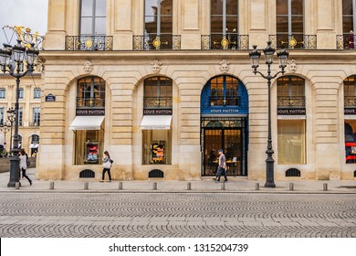 PARIS, FRANCE - JUNE 8, 2018: View of French luxury fashion house Louis Vuitton. Flagship store opened in heart of Place Vendome - a place where Louis Vuitton founded his first store in 1854.
