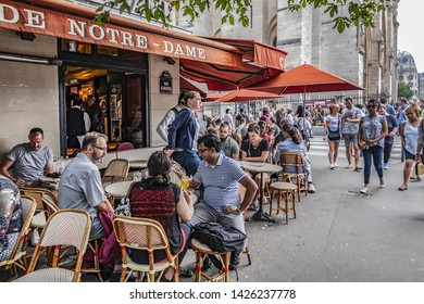PARIS, FRANCE - JUNE 8, 2018: Street Arcola (Rue d'Arcole). Rue d'Arcole - shopping district, is full of stores, gift shops, cafes. It goes from Notre-Dame cathedral to bridge of Arcole.