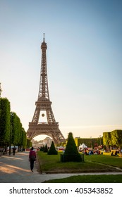 PARIS, FRANCE - JUNE 8: Eiffel tower with park around. Tower was designed by Gustave Eiffel and Stephen Sauvestre in 1889 and is one of main landmark of Paris. June 2015.