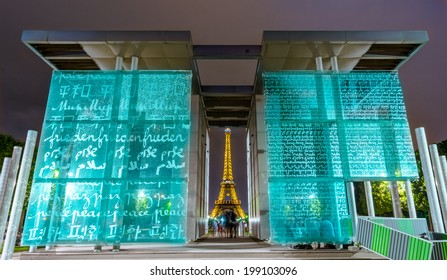 Paris, France - June 8th, 2014: Eiffel Tower illuminated at night-during Roland Garros tour. The Eiffel Tower was built in 1889, and is a popular attraction for tourists.