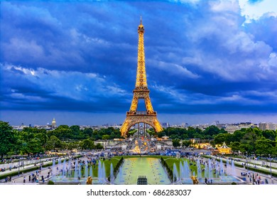 Paris, France - June 8th, 2014: Eiffel Tower illuminated at dusk-during Roland Garros tour. The Eiffel Tower was built in 1889, and is a popular attraction for tourists.