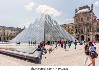 PARIS, FRANCE - JUNE 9, 2015: View Louvre Museum courtyard on the Sunset. Louvre Museum is one of the largest and most visited museums worldwide.