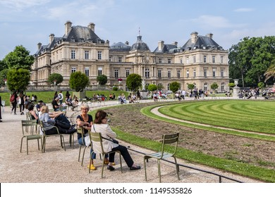 PARIS, FRANCE - JUNE 9, 2018: Tourists and Parisians relaxing in Luxembourg Garden (Jardin du Luxembourg). Jardin du Luxembourg - second largest Public Park in Paris.