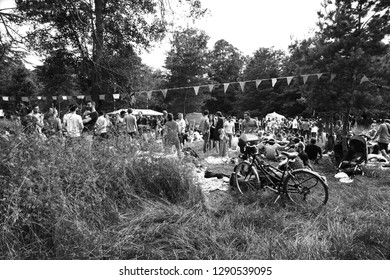 PARIS, FRANCE - JUNE 9, 2018:  Large group of people has green party in Vincennes forest of Paris.  Enjoy naturally socializing concept. Black and white photo.