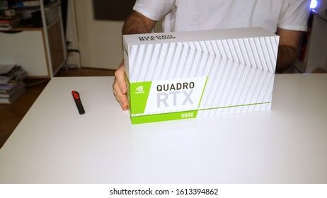 Paris, France - Mar 11, 2019: Curious man before unpacking new Nvidia Quadro RTX 5000 for workstations running professional CAD, CGI, DCC application software video card GPU
