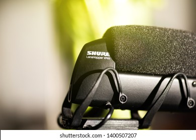 Paris, France - Mar 18, 2019: Logotype detail of new microphone made by Shure America MOdel VP 83 mounted on Panasonic GH5 mirrorless camera
