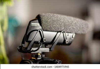 Paris, France - Mar 18, 2019: Detailed photograph of new microphone made by Shure VP 83 mounted on Panasonic GH5 mirrorless camera close-up on the logotype