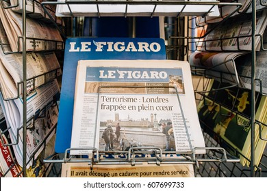 PARIS, FRANCE - MAR 23, 2017: Le Figaro French magazine newspaper from press kiosk newsstand featuring headlines following the terrorist incident in London at the Westminster Bridge