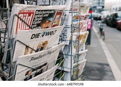 PARIS, FRANCE - MAR 23, 2017: Die Bild and other German international magazines covers at press kiosk newsstand featuring newsworthy headlines