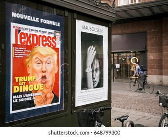 PARIS, FRANCE - MAR 23, 2017: French l'Express magazines cover wtih Donald Trum is Craxy cover at press kiosk newsstand (Trump est dingue in French)