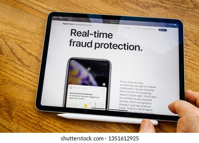 Paris, France - Mar 27, 2019: Man POV at iPad Pro tablet reading on Apple.com website about new Apple Card - real time fraud protection unusual activity detected