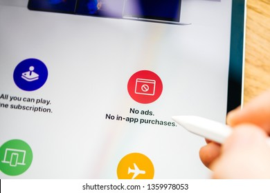 Paris, France - Mar 27, 2019: Focus on Apple Arcade features seen on modern Ipad Pro tablet featuring the new subscription model for over 100 groundbreaking new games no ads in-app purchases