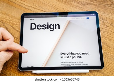 Paris, France Mar 27, 2019: Man hand POV looking at the new iPad Pro featuring Apple Computers website with latest Air tablet features story about design