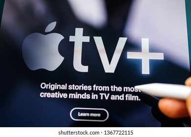 Paris, France - Mar 27, 2019: Defocused POV man holding Apple Pencil over the new iPad Pro Introducing Apple TV Plus streaming service for the creative minds - tilt-shift focus image