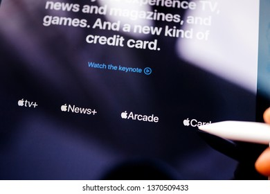 Paris, France - Mar 27, 2019: POV man holding Apple Pencil over the new iPad Pro featuring Apple TV Plus, News Plus and Arcade game subscription and new payment card service macro close-up