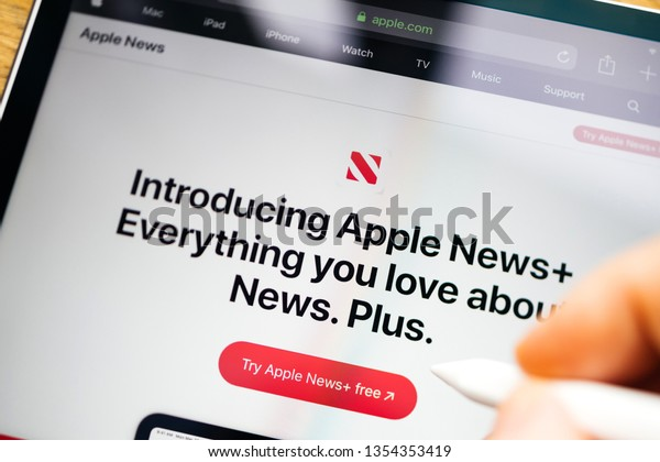 Paris, France - Mar 27, 2019: Apple News Plus demo website on iPad Pro showing introducing Apple News Plus Everything you love about news.Plus advertising