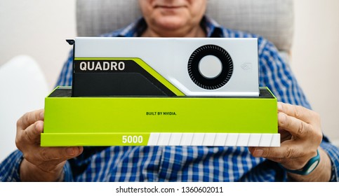 Paris, France - Mar 28 2019: Wide image of senior man showing demonstrating latest Nvidia Quadro RTX 5000 workstation GPU with powerful machine learning capabilities built by nvidia