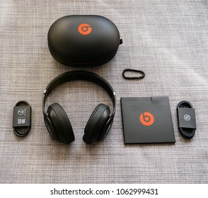 PARIS, FRANCE - MAR 31, 2018: View from above of new Beats 3 Studio professional wireless headphones made by Beats by Dr Dre Apple with all the accesories - unboxing process